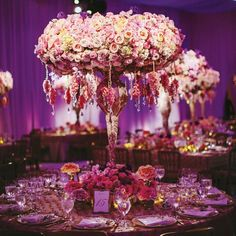 tabletop with roses and orchids centerpiece