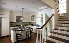 Transitional Kitchen with Flat panel cabinets, Hardwood floors, Undermount Sink, L-shaped, High ceiling, European Cabinets