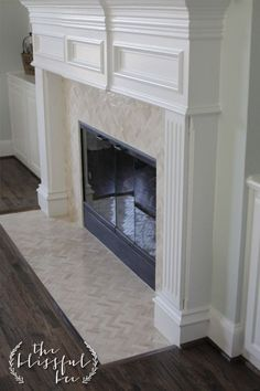 Fireplace - Herringbone tile - 1x3 inch marble tile with mesh backing (typically seen in back splashes).