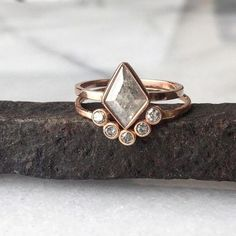 Love the look of this natural silver-grey geometric + bezel arc wedding + engagement ring combo.