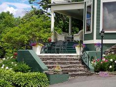 Peonies & overflowing flower pots at Greenville Inn #mooseheadlake #peonies #flowers #historicmansion #Maine