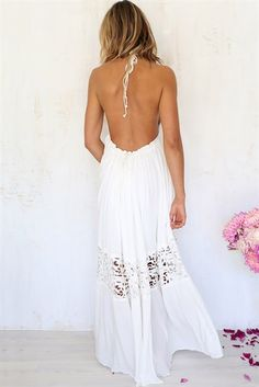 This backless white maxi dress is so cute.
