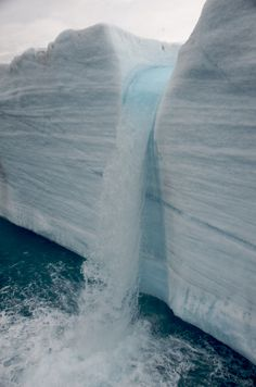 A meltwater waterfall from a glacier's edge.