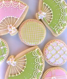 decorated cookies with piped royal icing lines and fan cookies