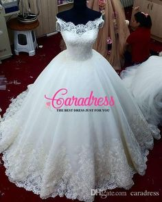 2016 Ball Gown Wedding Dresses Cap Sleeves Lace Bridal Dresses Beaded Appliques Real Picture Wedding Gowns Floor Length Lace up Back J1122