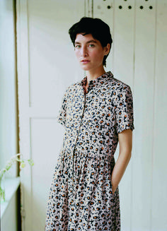 DAISY PRINT COTTON SATEEN SHIRT DRESS | Very soft, lightweight cotton sateen. Very lightly fitted. Neat, short collar. Short sleeves. Gathers into waist with topstitching detail. Gathers into back of neck. Below-knee-length. Pockets.