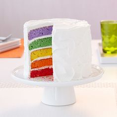 This cake is just beautiful, both inside and out! Simply add Wilton Icing Colors to your cake batter and bake in the Wilton Easy Layers! Cake Pan Set to create a rainbow of layers that will surprise and enchant your party guests. Make any gathering a celebration with this terrific torte.