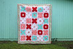 I finally was able to finish up the x's & o's quilt. I wasn't able to get to quilting it till this weekend since life got a littl...