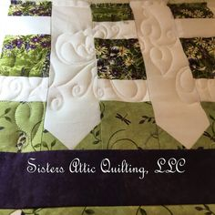 "Sisters Attic Quilting, LLC ... designed specifically for our mother and named respectfully ""My Mom's Garden"".  Flowers and butterflied in the picket fence with bumble bees and butterflies throughout the quilt."