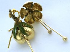 Items similar to Golden Petals - flower and painted metal leaf caps, with trailing golden stems, gold plated ear hooks, botanical jewellery on Etsy Painted Metal, Metallic Paint, Hair Accessories, Leaves, Creative, Earrings, Flowers, Gold, Handmade