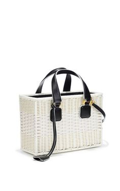 This **Mark Cross** rattan small tote features saffiano leather handles.