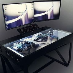 "From @rog_na - #ModMondays Fantastic desk build by Alex Coman featured on @nvidiageforce. The ""All-In"" work desk mod features an #ASUS X99 DELUXE, #intel i7-5820k, 2x #GeForce GTX980's, 16GB #Corsair Dominator DDR4, and a #ROG Swift PG278Q 27"" Monitor. #"
