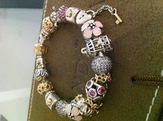 Pandora Bracelet 2013 Spring-Summer collection with 14k gold, silver  and Cherry Blossoms.