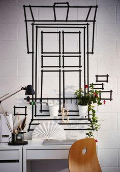 Black tape on a wall, shaped as a window.