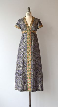 Vintage late 1960s regal silk brocade maxi dress with intermingling patterns, V neckline, short sleeves, brocade ribbon trim, empire waist and back