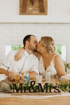 This beautiful bride had a messy low bun for her wedding day which was perfect for this summer wedding and her lace neckline wedding dress from the Wedding Shoppe! | bride and groom close up kissing picture at the head table | head table wedding decor | mr and mrs sign for head table | reception ideas & photos Head Table Wedding Decorations, Summer Wedding, Lace Wedding, Bridal Bun, Wedding Dress Necklines, Wedding Shoppe, Wedding Hair And Makeup, Wedding Looks, Reception Ideas