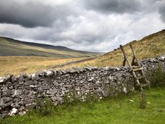dry stone wall and ladder stile at twisleton scar, yorkshire dales, yorkshire england