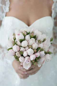 A wedding bouquet of pink David Austin roses by Joanne's Flowers Galore // Photography SugarLove Weddings.