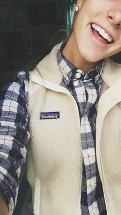 I'm really loving the white Padegonia jackets. The fact that this is a vest is adorbs!