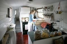 Cozy kitchen on houseboat.  Also love the closet organization in this tiny house (will have to click on picture to see expanded post and photos)