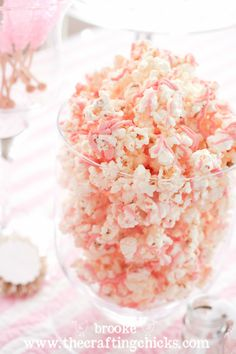 White chocolate, with pink food color, over popcorn @ALYSSA Wheeler I have had this before (minus the food coloring and add Sprinkles) and it is fantastic! I thought you might be interested in doing this as a snack for the bridal party and using food coloring to match the wedding colors