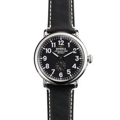 15da375cb3e The Runwell black leather watch with black face features a stainless steel  case along with a Swiss quality quartz Argonite 1069 movement, ...