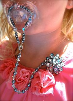 Gorgeous Baby Boutique 4-in-1 Beaded Pacifier Holder. $22.99, via Etsy.