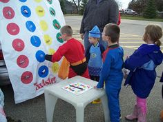 Here was another fun idea. Merritts had a twister game on the back of their van. The kids got to spin the spinner and pick candy from what ever color they ...