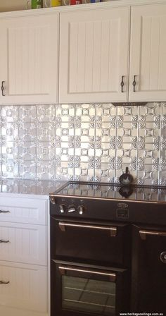 This is a pressed metal splashback in the Evans design. Panels can be painted any colour to suit your decor.  Home handy men can install the panels and they are budget priced.  For bigger photos see: http://www.heritageceilings.com.au/clients-projects/mcquiggin-pressed-metal-splashback.php