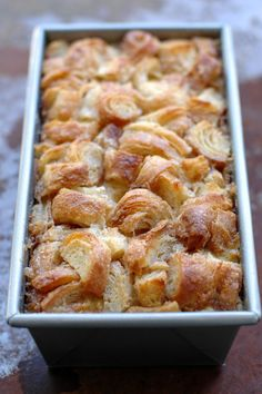 richest bread pudding; made with butter, cream, milk, croissants; served with a vanilla bean creme anglaise; extra thick bread pudding is made from croissant bread; there is twice the custard to bread; this bread pudding is crunchy on the outside and custardy smooth on the inside