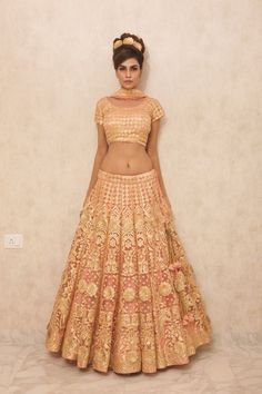 Sangeet Lehengas - Peach and Gold Lehenga with Gold Jaal Work | WedMeGood #wedmegood #sangeet #lehengas