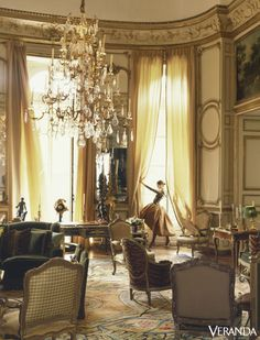 A large tiered chandelier hangs over the salon in Hubert de Givenchy's Paris residence, circa 1990.