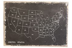 Wall decor showing a map of the United States with the abbreviation of each state in white on a black background.