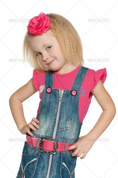 Little girl in jeans dress ...  adorable, alone, caucasian, cheerful, child, childhood, cute, emotion, enjoyment, european, fashion, front, girl, happiness, happy, indoor, isolated, jeans, kid, little, lovely, one, people, person, pleasure, portrait, positive, positivity, preschool, preschooler, pretty, single, smile, stand, studio, white, young