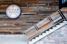Pioneer Millworks l This is reclaimed barn siding in a mix of tones, as wall paneling and stair railing panels. Reclaimed Wood Paneling, Reclaimed Barn Wood, Recycled Wood, Rustic Wood, Barn Siding, Wood Siding, Exterior Siding, Vintage Restaurant Design, Pallet Barn