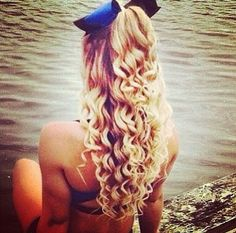 Curly cheer hair with poof in front