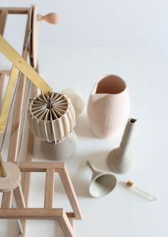 3D-printed ceramic tools for diluting and diffusing perfumes. by Unfold, Belgium. The items are printed from fine layers of ceramic that produce a stratified surface.