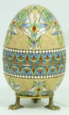 Fine Decorative Arts Russian Silver Enameled Egg Box Having Cloisonne Multicolor Scrolled Floral Design. Gold Wash Interior. Includes Stand with Three Figural Eagle's Feet. Measures 4 Inches in Height + 1/2 Inch Base Height