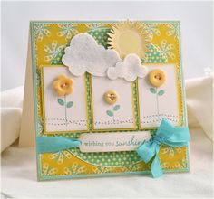 Debbie Olsen created this card from and idea in Making Cards from Scraps and Sketches | Ella Publishing Co.  I love the colors and buttons and stitching and felt clouds...