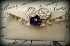 Natural Canvas Clutch- bridal, wedding, bridesmaid, bridal party, lace, purple flower, muslin rosettes - Ticket No. 175. $15.00, via Etsy.