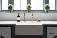 Aged brass Mayan taps by Perrin & Rowe work perfectly with moody paint colour Goose Iron in this new Spenlow utility room at our Felsted showroom, Essex Utility Room Sinks, Utility Room Storage, Farmhouse Style Kitchen, Farmhouse Decor, Ceramic Kitchen Sinks, Humphrey Munson, Ceramic Supplies