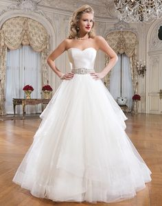 Shown in Natural/Silver Tulle, silk dupion ball gown featuring a strapless neckline. Available colors: Natural/Silver