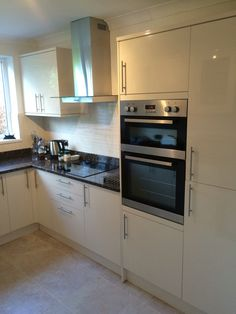 Cream gloss Howdens kitchen  Baltic brown granite tops