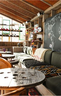 Love the #wood and #worldmap. It's a TOMS store interior but so much of it could work in a home too!
