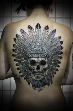 Tattooed Woman; Indian head dress on skull.