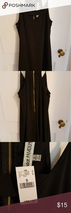 Little black dress with gold zipper Cute little black dress with cut out in the front and black bar detail. Gold zipper down the back. Never worn because it was too large. Almost Famous Dresses Mini