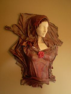 Leather sculpture of a red and bronze lady. by Sculptedleather