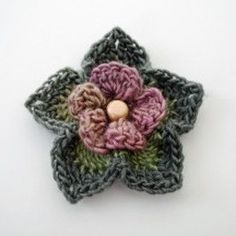 Enchanted Forest Flower- free pattern. Ideal for embellishing a simple knitted scarf, headband, bag or top.