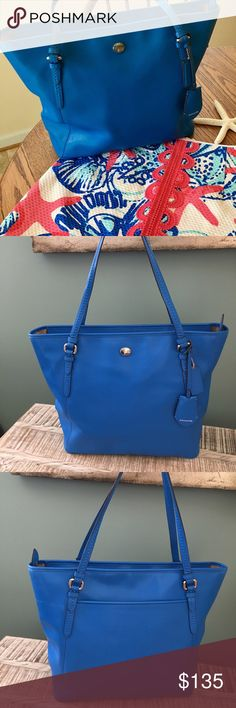 Coach Silver Cerulean Peyton Leather Tote F23749 This is a brand new Coach Peyton Leather Zip Top Tote - COACH F27349 - SILVER/CERULEAN  This is a gorgeous blue colored bag and perfect for the upcoming summer. The bag is in excellent condition. It has been previously carried but not for long. There is no dust bag and I do not have the original price tags.  Please let me know if you have any questions. Shipping is immediate from a smoke free home. Coach Bags Totes