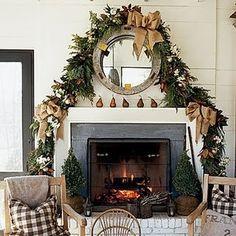 christmas mantle. Love the burlap bows.